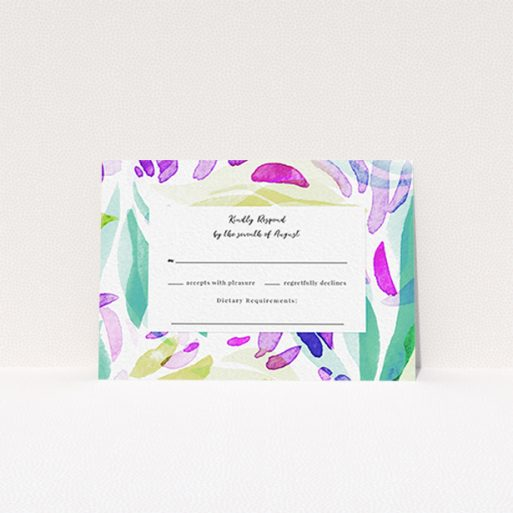"""A wedding rsvp card design called """"Neon Florals"""". It is an A7 card in a landscape orientation. """"Neon Florals"""" is available as a flat card, with tones of white, green and pink."""