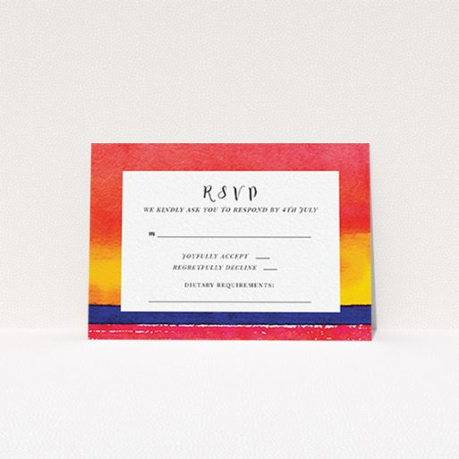"""A wedding rsvp card template titled """"Setting Sun"""". It is an A7 card in a landscape orientation. """"Setting Sun"""" is available as a flat card, with tones of red, yellow and navy blue."""