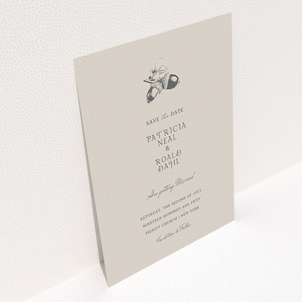"""A wedding save the date design named """"Acorn stamp"""". It is an A6 save the date in a portrait orientation. """"Acorn stamp"""" is available as a flat save the date, with mainly dark cream colouring."""