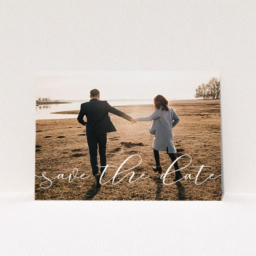 """A wedding save the date card design named """"Across the Photo"""". It is an A5 card in a landscape orientation. It is a photographic wedding save the date card with room for 1 photo. """"Across the Photo"""" is available as a flat card, with mainly white colouring."""