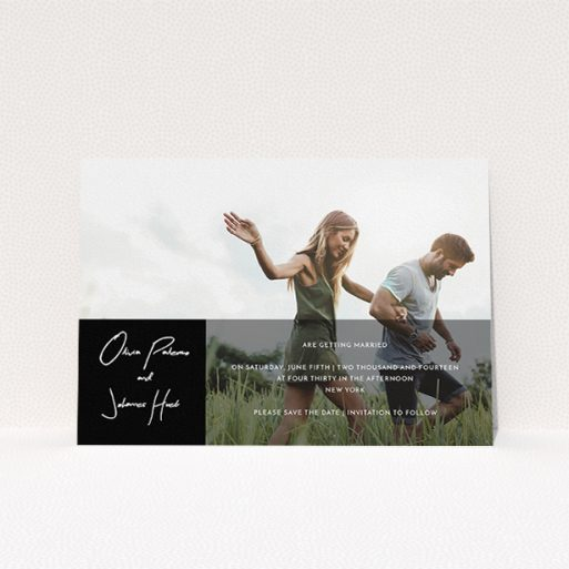 """A wedding save the date card design called """"Black on black"""". It is an A5 card in a landscape orientation. It is a photographic wedding save the date card with room for 1 photo. """"Black on black"""" is available as a flat card, with tones of black and white."""
