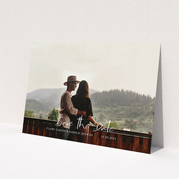 """A wedding save the date card named """"Central Script"""". It is an A5 card in a landscape orientation. It is a photographic wedding save the date card with room for 1 photo. """"Central Script"""" is available as a flat card, with mainly white colouring."""