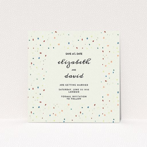 """A wedding save the date card called """"Crayon splinters"""". It is a square (148mm x 148mm) card in a square orientation. """"Crayon splinters"""" is available as a flat card, with tones of pale cream and orange."""