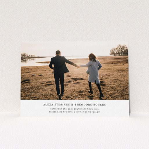 """A wedding save the date card design titled """"Duke of York Square"""". It is an A5 card in a landscape orientation. It is a photographic wedding save the date card with room for 1 photo. """"Duke of York Square"""" is available as a flat card, with mainly white colouring."""
