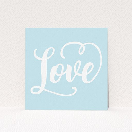 """A wedding save the date card called """"Folded Typography"""". It is a square (148mm x 148mm) card in a square orientation. """"Folded Typography"""" is available as a flat card, with tones of blue and white."""