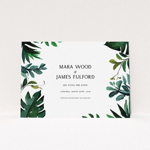 """A wedding save the date card called """"Gap in the Jungle"""". It is an A6 card in a landscape orientation. """"Gap in the Jungle"""" is available as a flat card, with tones of blue and green."""