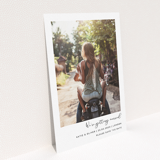 """A wedding save the date card template titled """"Hoxton Square"""". It is an A5 card in a portrait orientation. It is a photographic wedding save the date card with room for 1 photo. """"Hoxton Square"""" is available as a flat card, with mainly white colouring."""