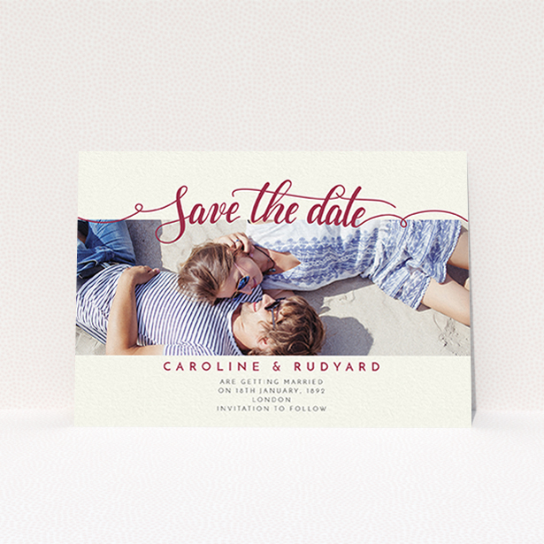 """A wedding save the date card design called """"Landscape Curly Typography"""". It is an A6 card in a landscape orientation. It is a photographic wedding save the date card with room for 1 photo. """"Landscape Curly Typography"""" is available as a flat card, with tones of pale cream and red."""