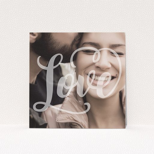 """A wedding save the date card template titled """"Light Typography"""". It is a square (148mm x 148mm) card in a square orientation. It is a photographic wedding save the date card with room for 1 photo. """"Light Typography"""" is available as a flat card, with mainly white colouring."""