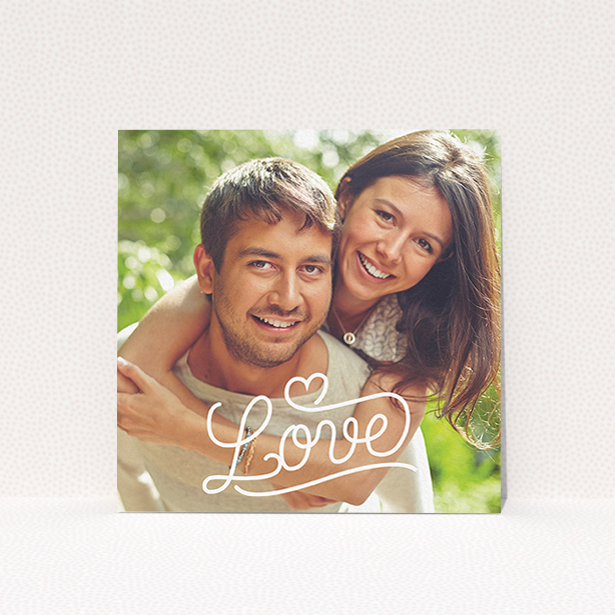 """A wedding save the date card design titled """"Love of Typography Photo"""". It is a square (148mm x 148mm) card in a square orientation. It is a photographic wedding save the date card with room for 1 photo. """"Love of Typography Photo"""" is available as a flat card, with mainly white colouring."""