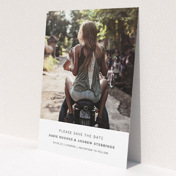 """A wedding save the date card named """"Maddox Street"""". It is an A5 card in a portrait orientation. It is a photographic wedding save the date card with room for 1 photo. """"Maddox Street"""" is available as a flat card, with mainly white colouring."""