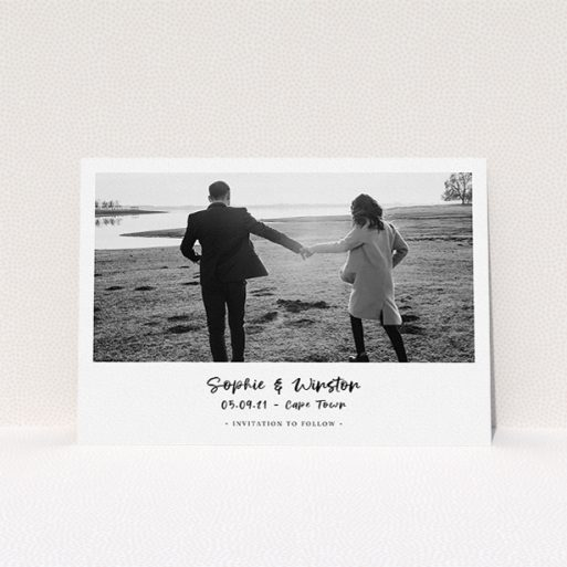 """A wedding save the date card template titled """"Monochrome Photo"""". It is an A5 card in a landscape orientation. It is a photographic wedding save the date card with room for 1 photo. """"Monochrome Photo"""" is available as a flat card, with mainly white colouring."""