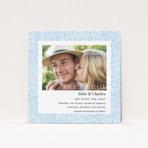 """A wedding save the date card design named """"Pastel flower border"""". It is a square (148mm x 148mm) card in a square orientation. It is a photographic wedding save the date card with room for 1 photo. """"Pastel flower border"""" is available as a flat card, with tones of blue and white."""