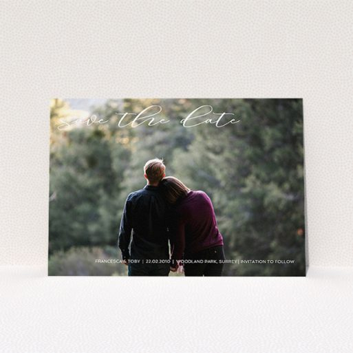 """A wedding save the date card called """"Photo Freedom"""". It is an A5 card in a landscape orientation. It is a photographic wedding save the date card with room for 1 photo. """"Photo Freedom"""" is available as a flat card, with mainly white colouring."""