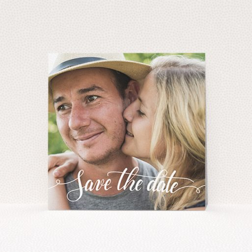 """A wedding save the date card design named """"Photo Typography"""". It is a square (148mm x 148mm) card in a square orientation. It is a photographic wedding save the date card with room for 1 photo. """"Photo Typography"""" is available as a flat card, with mainly white colouring."""