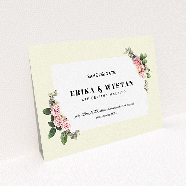 """A wedding save the date card design titled """"Roses on the corner"""". It is an A6 card in a landscape orientation. """"Roses on the corner"""" is available as a flat card, with tones of cream, pink and green."""