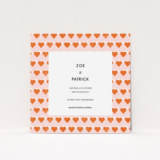 """A wedding save the date card called """"Rustic Hearts"""". It is a square (148mm x 148mm) card in a square orientation. """"Rustic Hearts"""" is available as a flat card, with tones of pink and orange."""