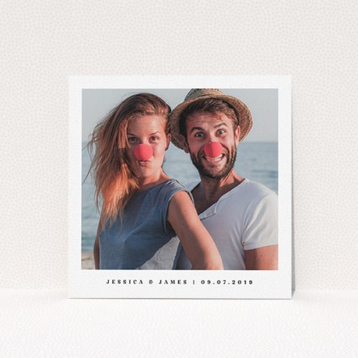 """A wedding save the date card named """"Simple Save"""". It is a square (148mm x 148mm) card in a square orientation. It is a photographic wedding save the date card with room for 1 photo. """"Simple Save"""" is available as a flat card, with mainly white colouring."""