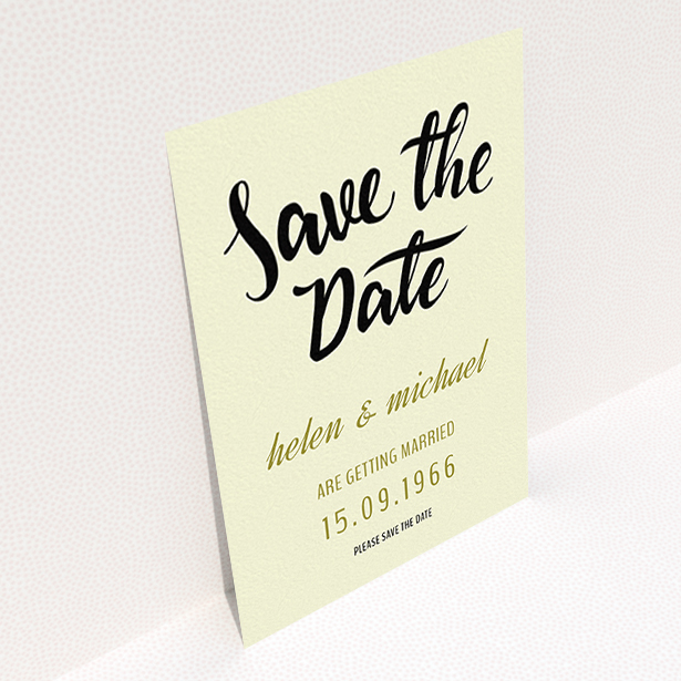 """A wedding save the date card called """"Simply Black Typography Pen"""". It is an A6 card in a portrait orientation. """"Simply Black Typography Pen"""" is available as a flat card, with tones of cream, gold and black."""