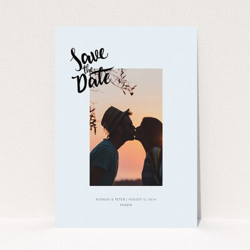 """A wedding save the date card design titled """"Stamp Typography"""". It is an A5 card in a portrait orientation. It is a photographic wedding save the date card with room for 1 photo. """"Stamp Typography"""" is available as a flat card, with mainly light blue colouring."""