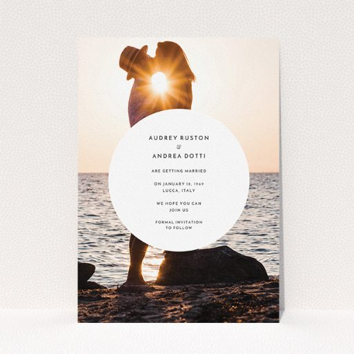 """A wedding save the date card design called """"Surrounded"""". It is an A5 card in a portrait orientation. It is a photographic wedding save the date card with room for 1 photo. """"Surrounded"""" is available as a flat card, with mainly white colouring."""