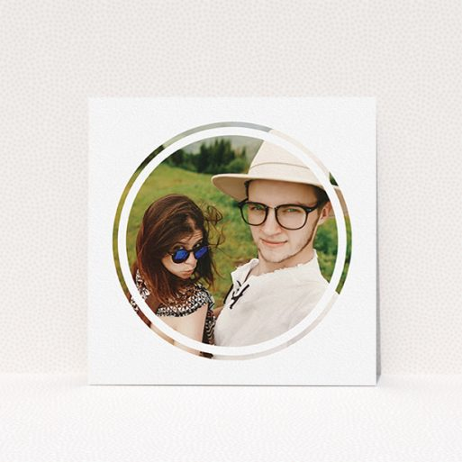 """A wedding save the date card named """"Target practice"""". It is a square (148mm x 148mm) card in a square orientation. It is a photographic wedding save the date card with room for 1 photo. """"Target practice"""" is available as a flat card, with mainly white colouring."""