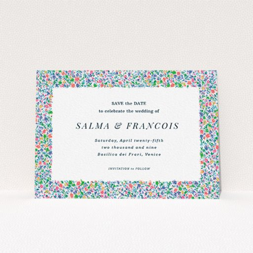 """A wedding save the date card called """"The faraway garden"""". It is an A6 card in a landscape orientation. """"The faraway garden"""" is available as a flat card, with tones of white, blue and green."""