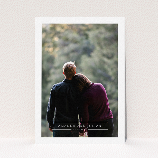 """A wedding save the date card called """"Tramlines"""". It is an A5 card in a portrait orientation. It is a photographic wedding save the date card with room for 1 photo. """"Tramlines"""" is available as a flat card, with mainly white colouring."""