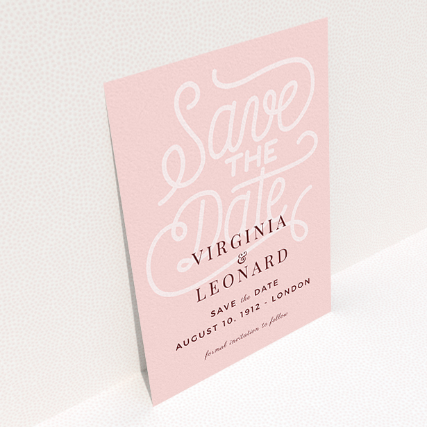 """A wedding save the date card design titled """"Typography Backing"""". It is an A6 card in a portrait orientation. """"Typography Backing"""" is available as a flat card, with mainly pink colouring."""