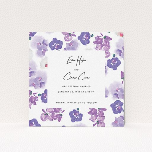 """A wedding save the date card design named """"Violet Explosion"""". It is a square (148mm x 148mm) card in a square orientation. """"Violet Explosion"""" is available as a flat card, with mainly purple/dark pink colouring."""