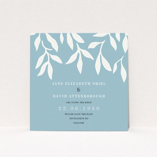 """A wedding save the date card named """"Winter bloom"""". It is a square (148mm x 148mm) card in a square orientation. """"Winter bloom"""" is available as a flat card, with tones of blue and white."""