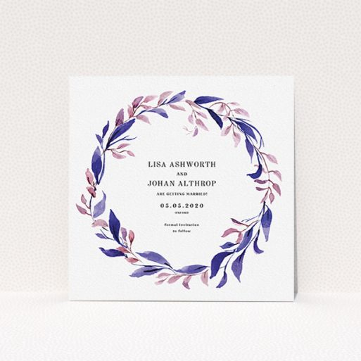"""A wedding save the date design called """"Hues of Blue"""". It is a square (148mm x 148mm) save the date in a square orientation. """"Hues of Blue"""" is available as a flat save the date, with mainly purple/dark pink colouring."""