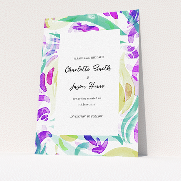 """A wedding save the date design called """"Neon Florals"""". It is an A6 save the date in a portrait orientation. """"Neon Florals"""" is available as a flat save the date, with tones of white and green."""