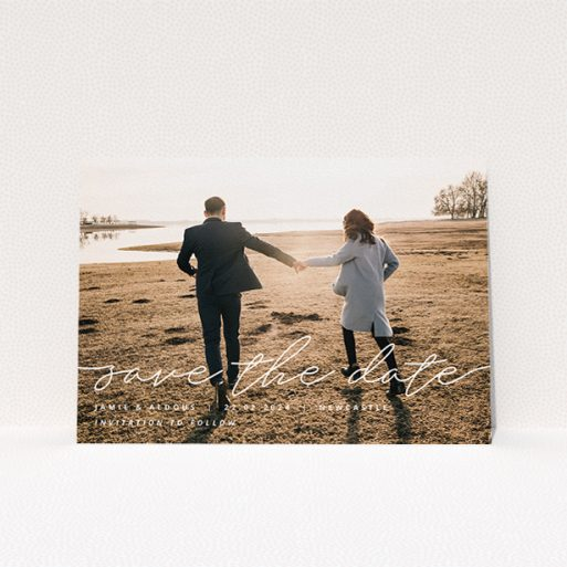 """A wedding save the date design titled """"Save the Date Script"""". It is an A5 save the date in a landscape orientation. It is a photographic wedding save the date with room for 1 photo. """"Save the Date Script"""" is available as a flat save the date, with mainly white colouring."""