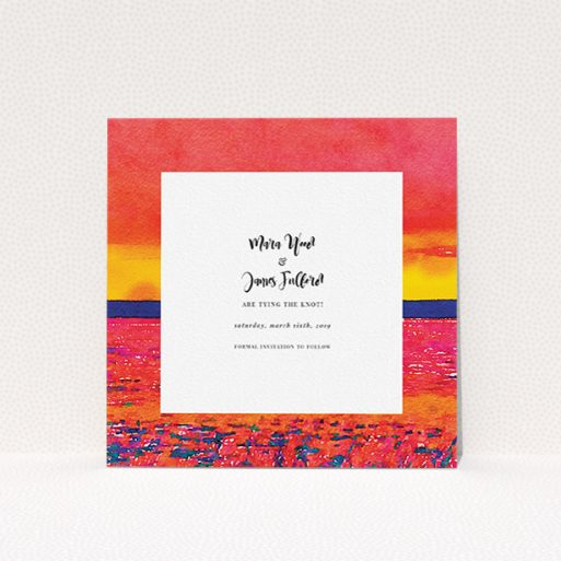 """A wedding save the date design named """"Setting Sun"""". It is a square (148mm x 148mm) save the date in a square orientation. """"Setting Sun"""" is available as a flat save the date, with tones of red, yellow and navy blue."""