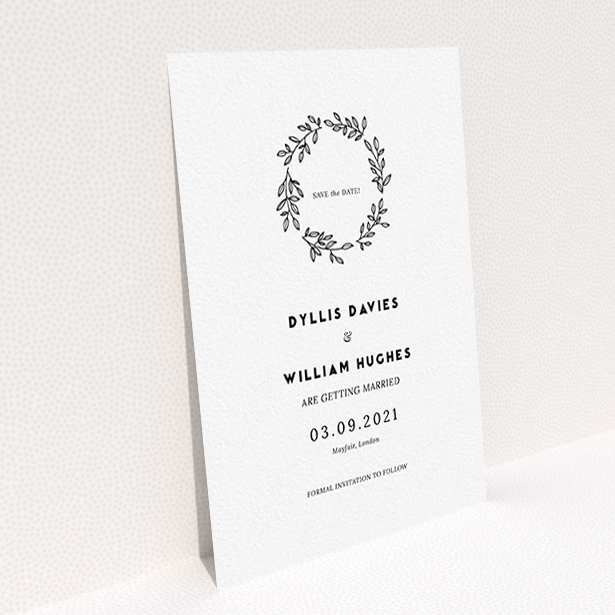 """A wedding save the date design titled """"Simple Wreath"""". It is an A6 save the date in a portrait orientation. """"Simple Wreath"""" is available as a flat save the date, with mainly white colouring."""