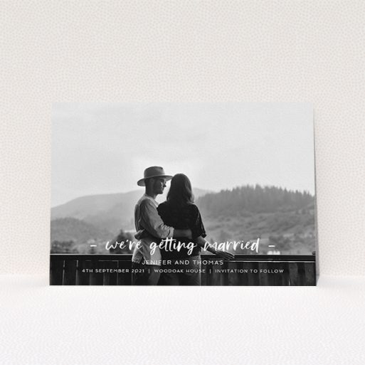 """A wedding save the date called """"To the Point"""". It is an A5 save the date in a landscape orientation. It is a photographic wedding save the date with room for 1 photo. """"To the Point"""" is available as a flat save the date, with mainly white colouring."""