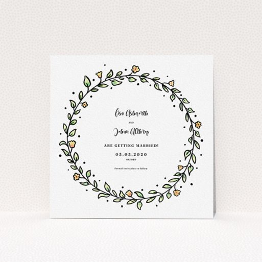 """A wedding save the date template titled """"Wreath Outline"""". It is a square (148mm x 148mm) save the date in a square orientation. """"Wreath Outline"""" is available as a flat save the date, with tones of light green and orange."""