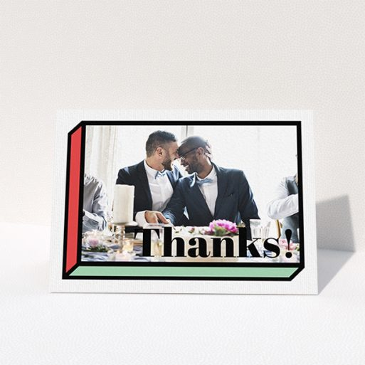 """A wedding thank you card called """"3D Thank You"""". It is an A6 card in a landscape orientation. It is a photographic wedding thank you card with room for 1 photo. """"3D Thank You"""" is available as a folded card, with tones of red, green and black."""