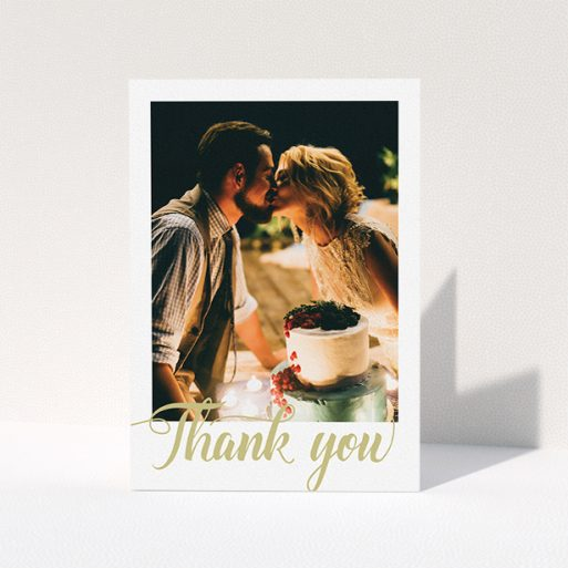 """A wedding thank you card design called """"A big thank you"""". It is an A5 card in a portrait orientation. It is a photographic wedding thank you card with room for 1 photo. """"A big thank you"""" is available as a folded card, with tones of white and gold."""