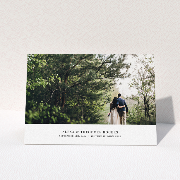 """A wedding thank you card called """"A Modern Classic Thank You"""". It is an A5 card in a landscape orientation. It is a photographic wedding thank you card with room for 1 photo. """"A Modern Classic Thank You"""" is available as a folded card, with mainly white colouring."""