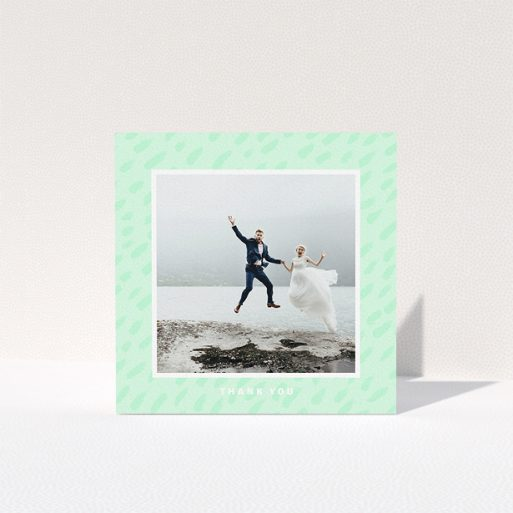 """A wedding thank you card design named """"A symphony in green"""". It is a square (148mm x 148mm) card in a square orientation. It is a photographic wedding thank you card with room for 1 photo. """"A symphony in green"""" is available as a folded card, with tones of green and white."""