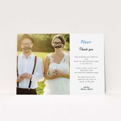 """A wedding thank you card named """"Abstract blue thanks"""". It is an A5 card in a landscape orientation. It is a photographic wedding thank you card with room for 1 photo. """"Abstract blue thanks"""" is available as a flat card, with tones of white and blue."""