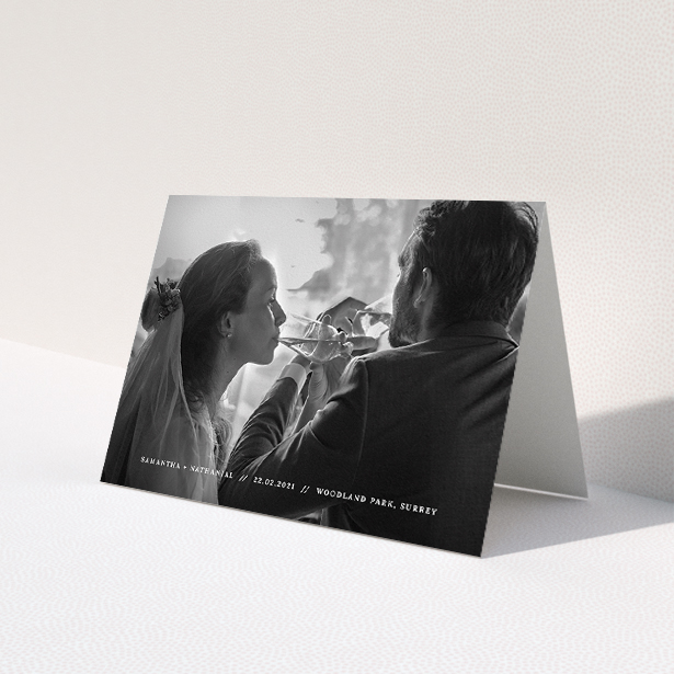 """A wedding thank you card design called """"Along the bottom"""". It is an A5 card in a landscape orientation. It is a photographic wedding thank you card with room for 1 photo. """"Along the bottom"""" is available as a folded card, with mainly white colouring."""