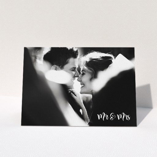 """A wedding thank you card called """"Black and White"""". It is an A5 card in a landscape orientation. It is a photographic wedding thank you card with room for 1 photo. """"Black and White"""" is available as a folded card, with mainly white colouring."""