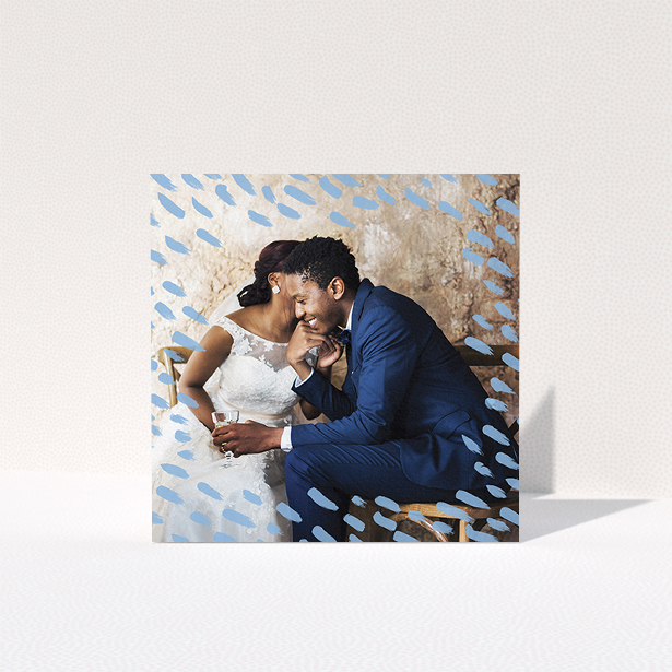 """A wedding thank you card template titled """"Blue smudge"""". It is a square (148mm x 148mm) card in a square orientation. It is a photographic wedding thank you card with room for 1 photo. """"Blue smudge"""" is available as a folded card, with mainly blue colouring."""