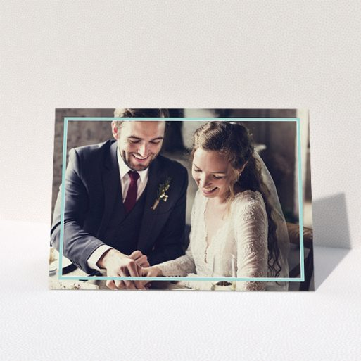 """A wedding thank you card called """"Blue White Photo Frame"""". It is an A5 card in a landscape orientation. It is a photographic wedding thank you card with room for 1 photo. """"Blue White Photo Frame"""" is available as a folded card, with mainly blue colouring."""