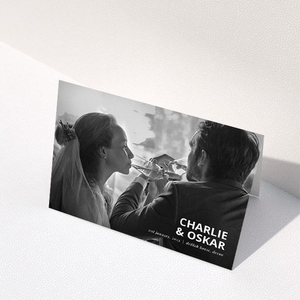 """A wedding thank you card design named """"Bold Photo Corner"""". It is an A5 card in a landscape orientation. It is a photographic wedding thank you card with room for 1 photo. """"Bold Photo Corner"""" is available as a folded card, with mainly white colouring."""