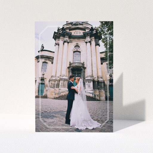 """A wedding thank you card design called """"Chiselled border"""". It is an A5 card in a portrait orientation. It is a photographic wedding thank you card with room for 1 photo. """"Chiselled border"""" is available as a folded card, with mainly white colouring."""