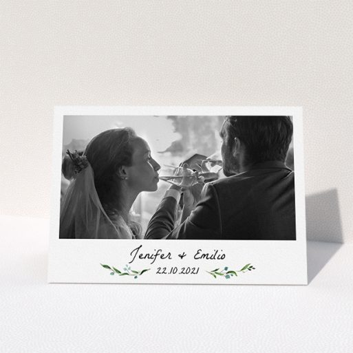 """A wedding thank you card named """"Classic Floral"""". It is an A5 card in a landscape orientation. It is a photographic wedding thank you card with room for 1 photo. """"Classic Floral"""" is available as a folded card, with tones of green and white."""